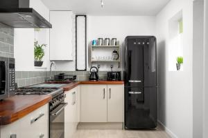 A kitchen or kitchenette at The Coach House Montpellier