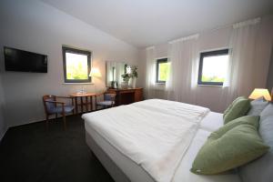 Ein Bett oder Betten in einem Zimmer der Unterkunft Hotel Moritz an der Elbe