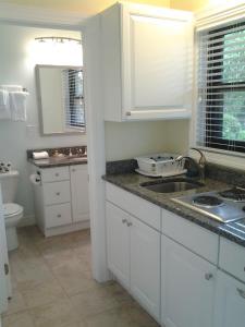 A kitchen or kitchenette at Surf & Sand Beach Motel