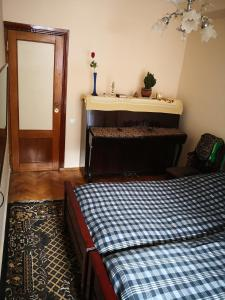A bed or beds in a room at Apartment Erekle