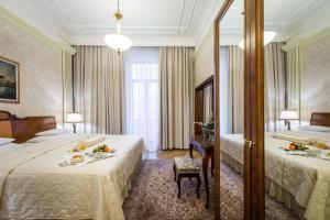 Кровать или кровати в номере Hotel Moskva