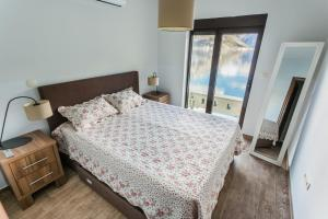 A bed or beds in a room at Sunshine of Montenegro Apartments