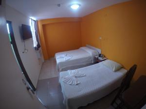 A bed or beds in a room at Hotel Villa del Mar