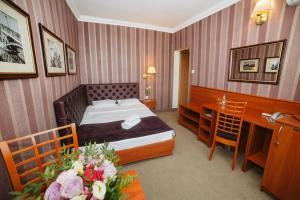 Łóżko lub łóżka w pokoju w obiekcie Hotel Europejski