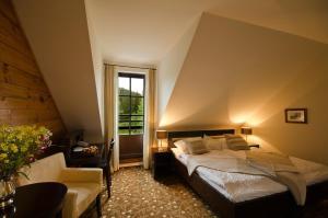 Ein Bett oder Betten in einem Zimmer der Unterkunft Hotel Annín