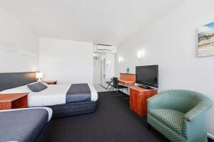 A television and/or entertainment center at Coach House Launceston