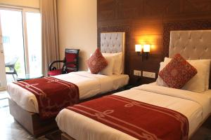 A bed or beds in a room at Hotel Surya, Kaiser Palace