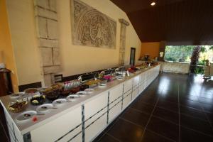 Een restaurant of ander eetgelegenheid bij Holiday Calbis Hotel