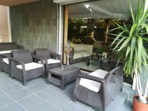 Ein Sitzbereich in der Unterkunft Family Hotel Kosko