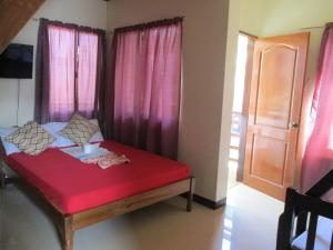 A bed or beds in a room at Zaniya's Pension