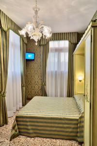 Cama o camas de una habitación en Hotel Al Malcanton