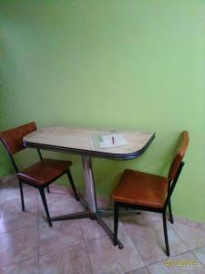 Área para comer en la habitación en casa particular