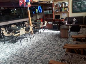 The lounge or bar area at Andescamp Hostel