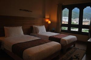 A bed or beds in a room at Gakyil Thimphu