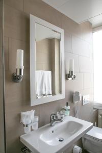 Ein Badezimmer in der Unterkunft Hotel Metropol