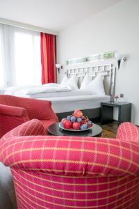 Ein Bett oder Betten in einem Zimmer der Unterkunft Hotel Metropol