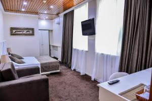 A television and/or entertainment centre at East Legend Hotel
