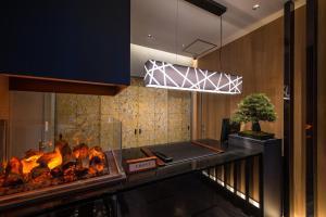 A kitchen or kitchenette at Hotel ZEN Sennichimae (Adult Only)