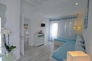 A seating area at Anemoessa Mykonos