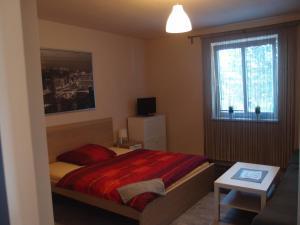Postel nebo postele na pokoji v ubytování Pension STYL