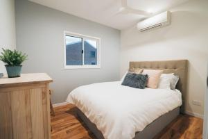 A bed or beds in a room at Begley Views - Boutique Apartment