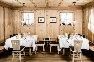 A restaurant or other place to eat at Boutique Hotel Nives - Luxury & Design in the Dolomites