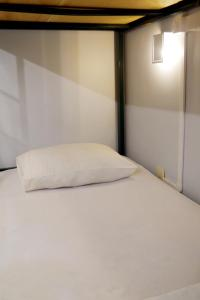 A bed or beds in a room at Mango Tree Ipanema