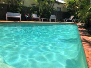 The swimming pool at or near Airport Clayfield Motel