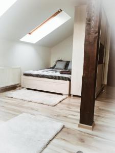 A bed or beds in a room at Miły Zakątek