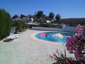 The swimming pool at or near Cortijo Clemente