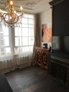 TV i/ili multimedijalni sistem u objektu Canal House 1680