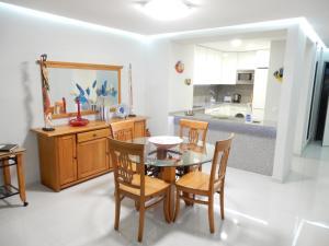 A kitchen or kitchenette at Apartamentos Turisticos Perola da Rocha