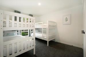 A bunk bed or bunk beds in a room at Sorrento Beach Escape