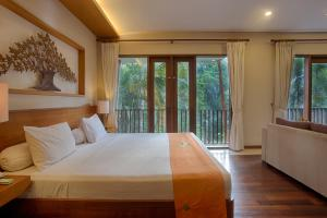 A bed or beds in a room at Anahata Villas and Spa Resort