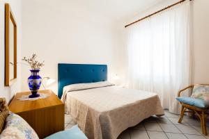 A bed or beds in a room at Casa Dorothea 1