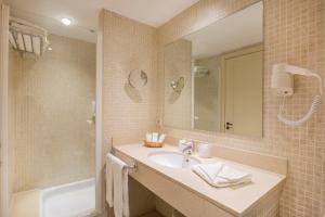 Ein Badezimmer in der Unterkunft Aparthotel Shusski