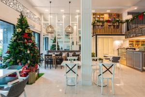 Restaurant ou autre lieu de restauration dans l'établissement White Ivory Bed And Breakfast