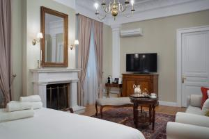 A bed or beds in a room at Noble Suites