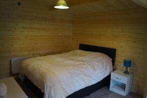 A bed or beds in a room at The Cabin Stretford