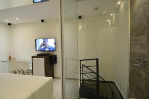 A television and/or entertainment centre at Eros Hotel CDU (Adults Only)