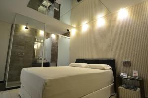A bed or beds in a room at Eros Hotel CDU (Adults Only)