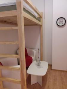 A bunk bed or bunk beds in a room at Living in the Box