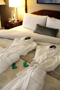 A bed or beds in a room at Magnolia Hotel & Spa