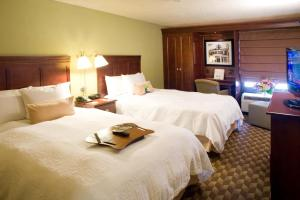 A bed or beds in a room at Hampton Inn I-10 & College Drive
