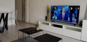 A television and/or entertainment centre at Palm beach Cannes Azur