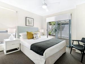 A bed or beds in a room at Home by the Sea
