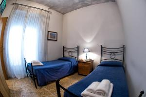 A bed or beds in a room at Giornate Romane