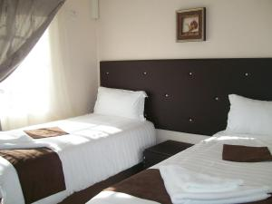 A bed or beds in a room at The Gibeon Ville Self-Catering