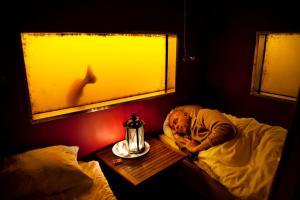 Säng eller sängar i ett rum på Utter Inn