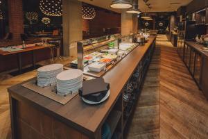 Restoran või mõni muu söögikoht majutusasutuses Metropol Spa Hotel